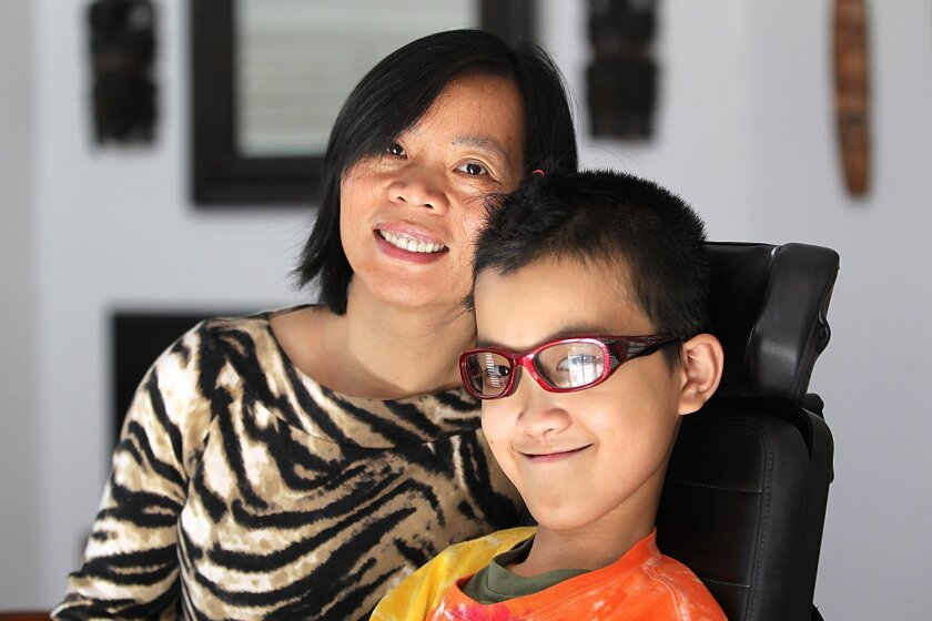 Jenny Wong, left, is mother to Ben Lou, 11.  Here they are in their Poway home.