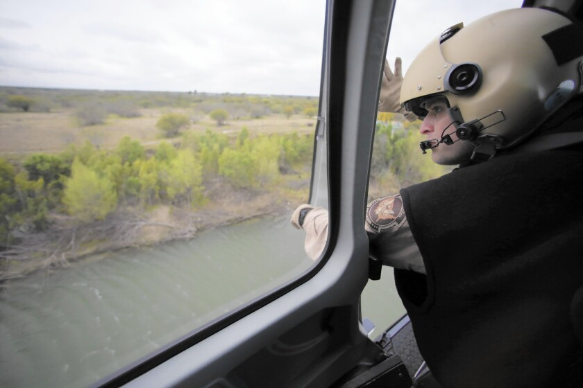 U.S. Customs and Border Protection agents patrol along the Rio Grande on the Texas-Mexico border.