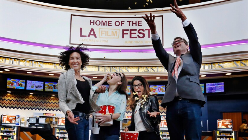 Los Angeles Film Festival director Stephanie Allain, left, programmer Jennifer Cochis and associate director Roya Rastegar celebrate the new fest with Josh Welsh, president of Film Independent, at the Regal Cinemas in downtown Los Angeles.
