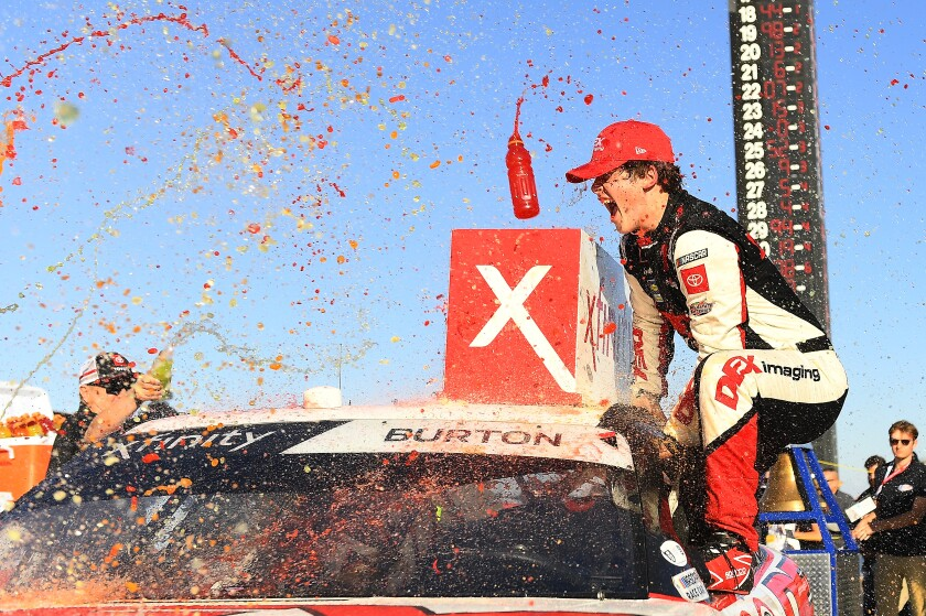 Harrison Burton celebrates his Xfinity Series victory in the Production Alliance Group 300 in Fontana on Feb. 29, 2020.