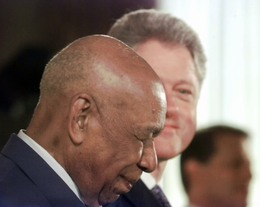 Herman Shaw, 94, a victim of the Tuskegee experiment, after receiving an official apology from President Clinton on May 16, 1997, in the White House.