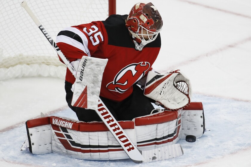 New Jersey Devils goaltender Cory Schneider makes a save during the third period of an NHL hockey game against the St. Louis Blues, Friday, March 6, 2020, in Newark. (AP Photo/John Minchillo)