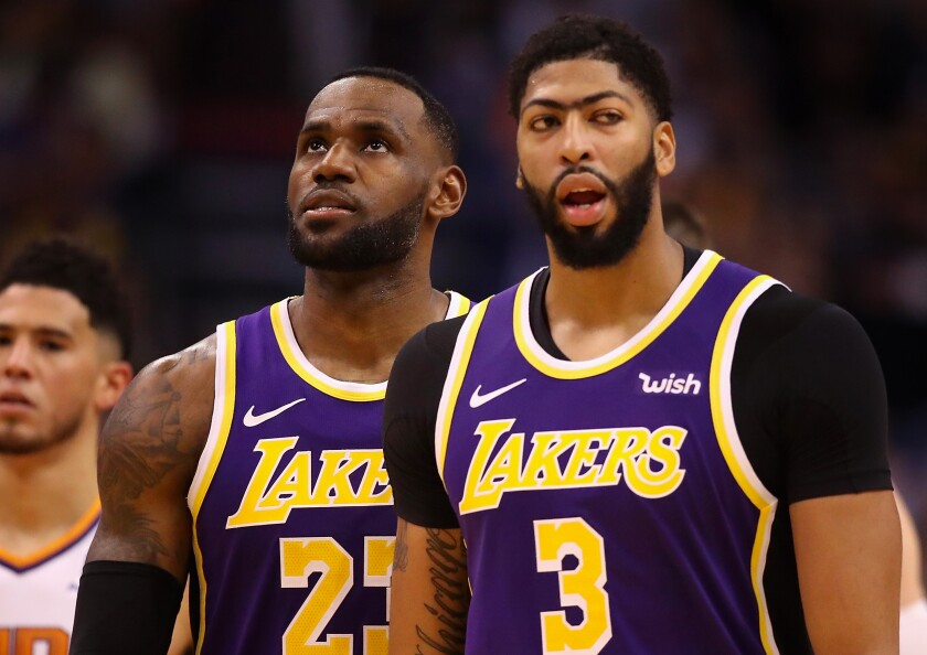 Lakers forward LeBron James chose teammate Anthony Davis (3) with the first pick in the All-Star game draft on Thursday.