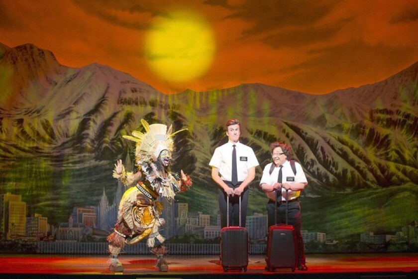 """Phyre Hawkins, left, Gavin Creel and Jared Gertner in """"The Book of Mormon"""" at the Pantages Theatre."""