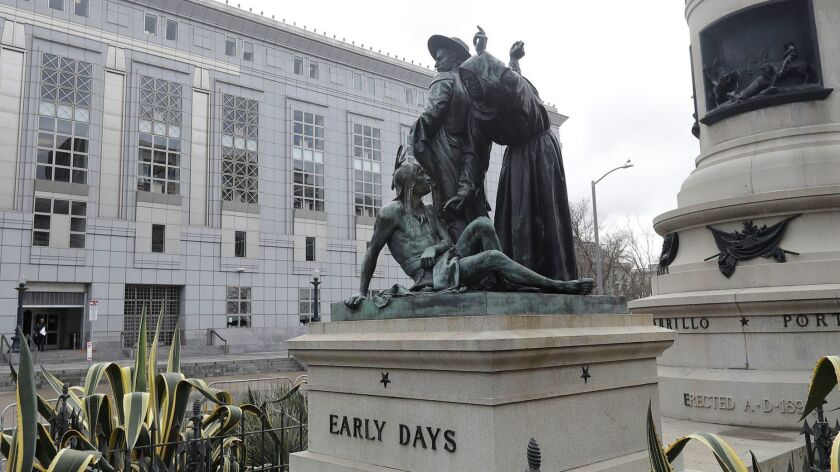 "The ""Early Days"" statue depicts a Native American at the feet of a Spanish cowboy and a Catholic missionary."