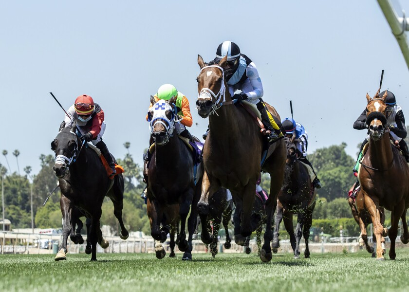 She's So Special, center right, with Flavien Prat aboard, wins the first horse race at Santa Anita Park on Friday.