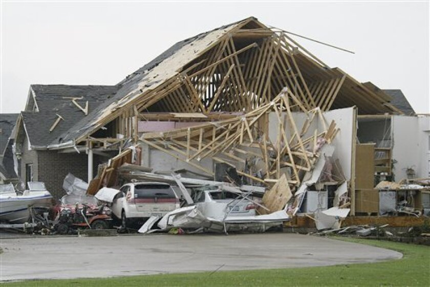 Insurers are wrestling with the question of whether climate change is contributing to disasters such as hurricanes and tornadoes, like this one that ripped through Kirksville, Mo., in May. (AP Photo/Al Maglio)