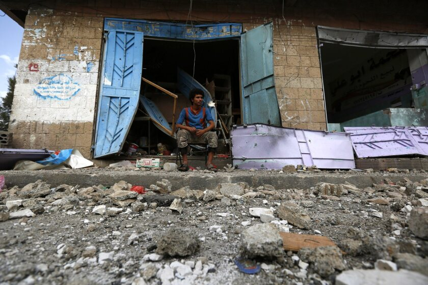 A Yemeni sits outside his shop destroyed by an airstrike of the Saudi-led coalition hit a neighborhood in Sana on May 27.