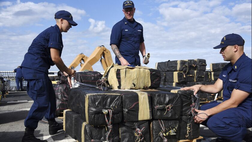 Coast Guardsmen prepare to offload seized cocaine in San Diego in this October 2018 file photo. A leader in the Juarez drug cartel indicted in 1998 recently pleaded guilty to transporting cocaine and other narcotics to the U.S. and laundering the drug proceeds.