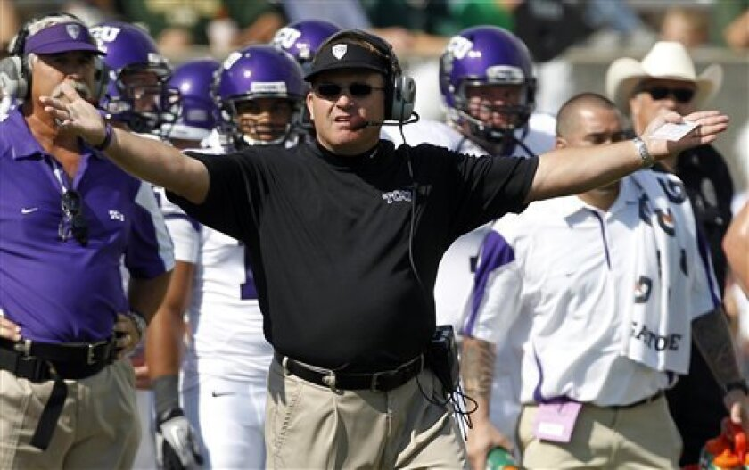 TCU head coach Gary Patterson throws his arms up during the second quarter of an NCAA college football game against Colorado State, Saturday, Oct. 2, 2010, in Fort Collins, Colo. (AP Photo/Jack Dempsey)