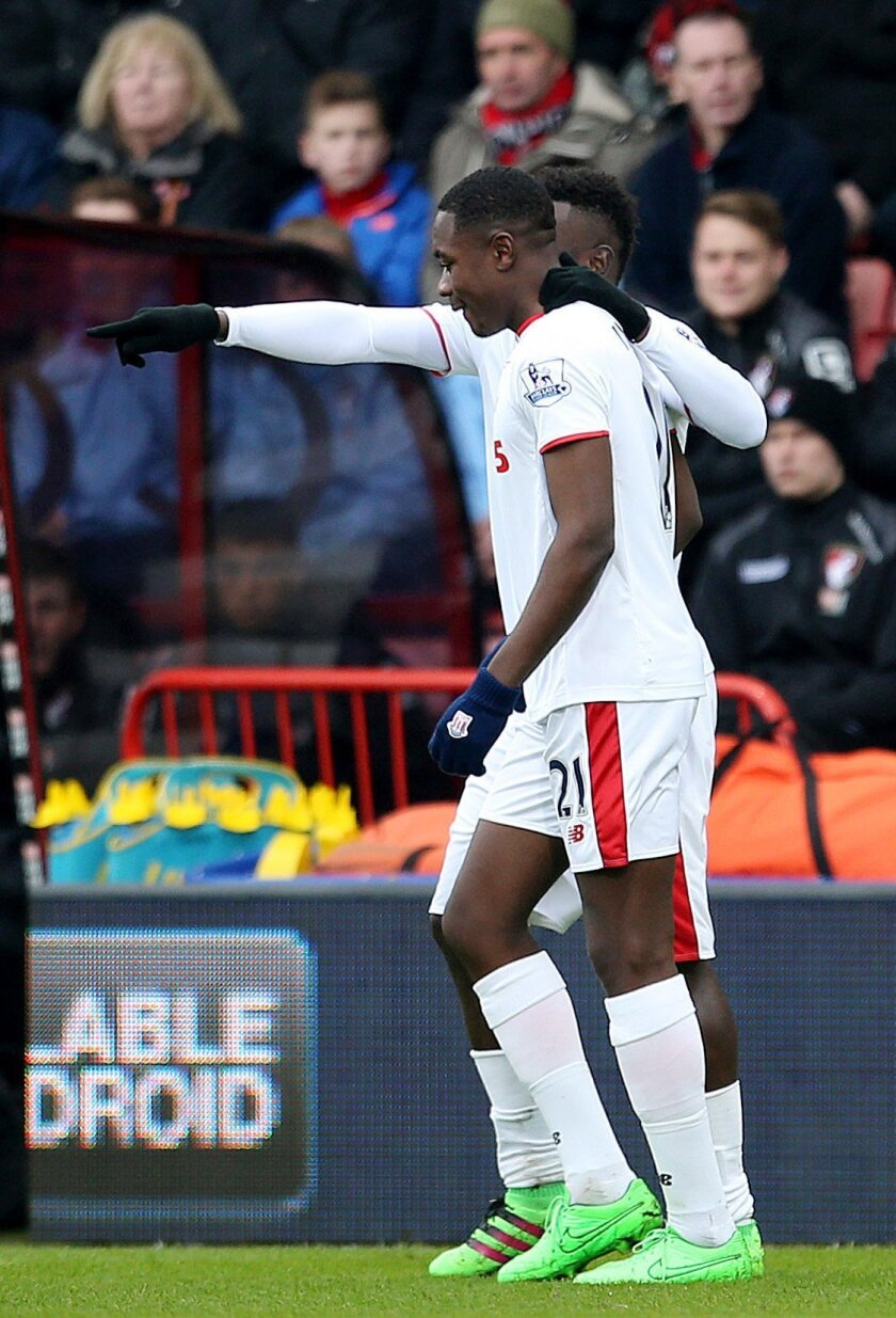 Stoke City's Giannelli Imbula, front, celebrates scoring against Bournetmouth during the English Premier League soccer match at the Vitality Stadium, Bournemouth, England, Saturday Feb. 13, 2016. (Steve Paston/PA via AP) UNITED KINGDOM OUT