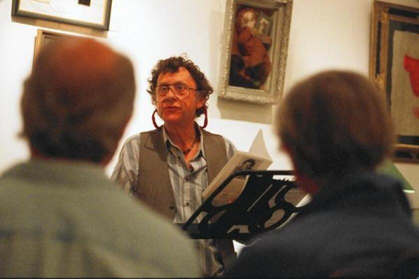 Steve Kowit, shown at a poetry reading at the Writing Center in San Diego, died April 2 at his home in Potrero.