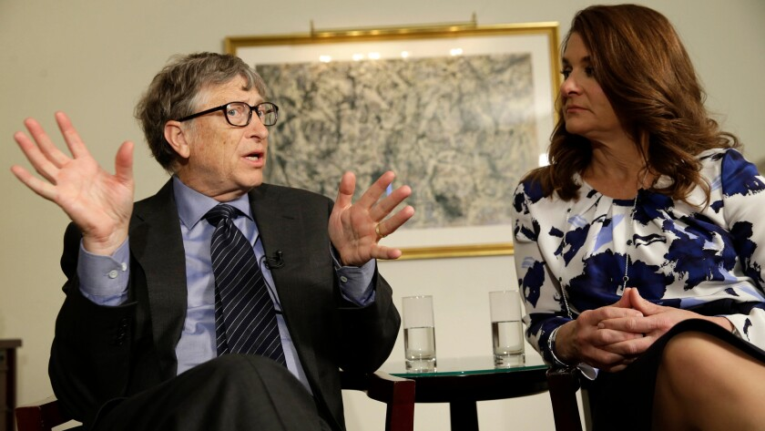 Bill and Melinda Gates talk to reporters about their foundation in New York on Feb. 22. The two are co-chairs of the largest private foundation in the world.