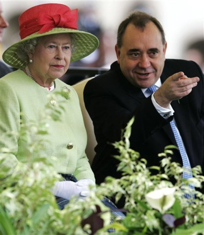 FILE - A Saturday, June 30, 2007 photo from files showing Britain's Queen Elizabeth II with Scotland's First Minister Alex Salmond as they view the riding procession during the ceremonial opening of the Scottish Parliament in Edinburgh. Britain's government said Tuesday Jan. 10, 2012, it will give Scotland the power to hold a binding vote that would give it independence from Britain, turning back centuries of history. Scotland's ruling Scottish National Party, which has long advocated independence, had pledged to hold a referendum before 2016. Under law, only Britain's Parliament can order a binding vote _ meaning it must temporarily offer the power to Scotland's semiautonomous administration. (AP Photo/Andrew Milligan, Pool)
