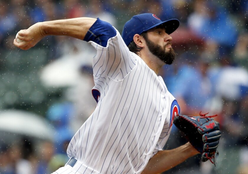 Chicago Cubs starter Jason Hammel throws against the Arizona Diamondbacks during the first inning of a baseball game Saturday, June 4, 2016, in Chicago. (AP Photo/Nam Y. Huh)