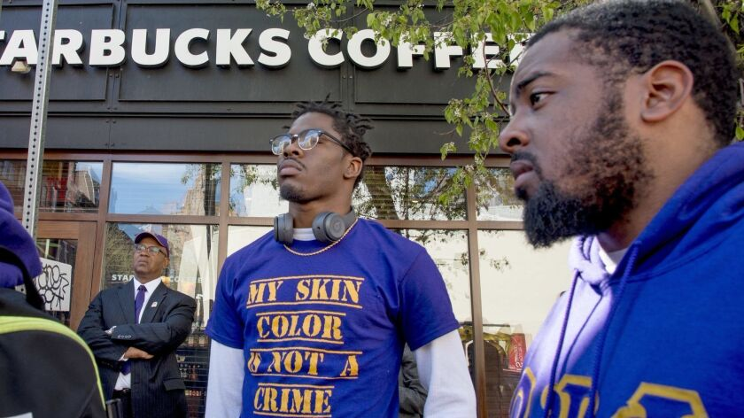 Omega Psi Phi Fraternity members Reese Tillman, right, and Bucketo Mitchell at a rally outside the Philadelphia Starbucks where one of their fraternity brothers was one of the two black men arrested at for trespassing,