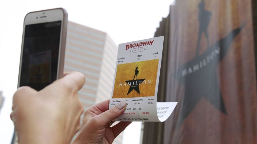 "Tickets to the touring musical, ""Hamilton,"" are so revered that this attendee from Seattle is taking a photo of her ticket to the San Diego Civic Theatre's opening show. The play closes January 28."