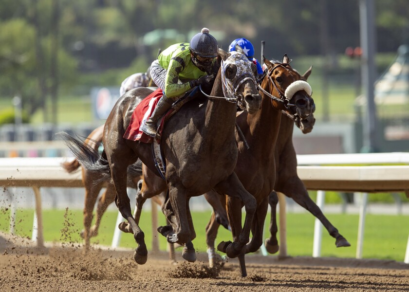 Smiling Shirlee, left, with Mike Smith aboard, outlegs Bella Vita, right, with Umberto Rispoli aboard, to win the $150,000 Evening Jewel Stakes horse race Saturday at Santa Anita Park.
