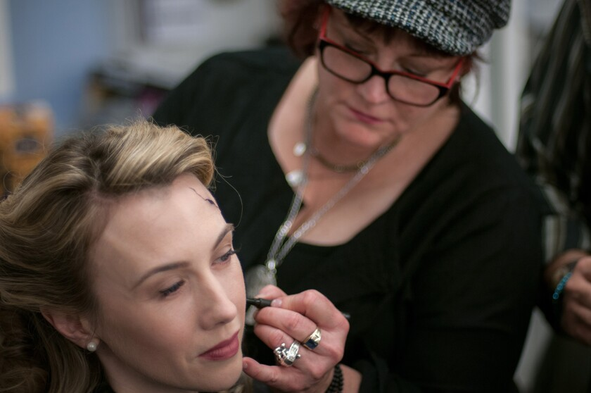 """Actress Wynn Everett in the makeup chair for """"Agent Carter"""" with make up artist Robin Beauchesne."""