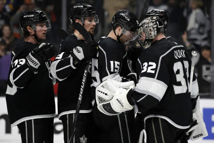 Kings goaltender Jonathan Quick (32) celebrates with teammates after a 5-3 win over the Flyers on Dec. 31 at Staples Center.