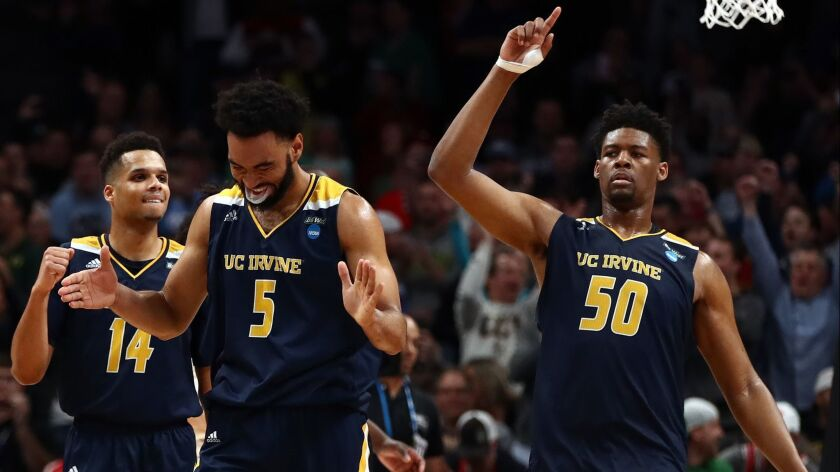 UC Irvine's Evan Leonard, left, Jonathan Galloway, center, and Elston Jones celebrate the Anteaters' victory over Kansas State in the first round of the NCAA tournament on Friday.
