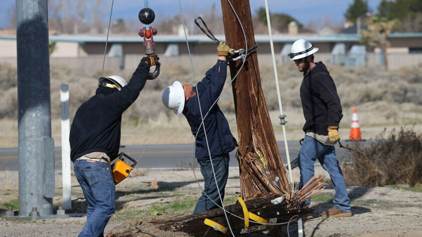 Edison crew repairs a power pole after an accident involving a school bus and a vehicle at East 20th Street and East Lancaster Boulevard Tuesday morning in Lancaster.