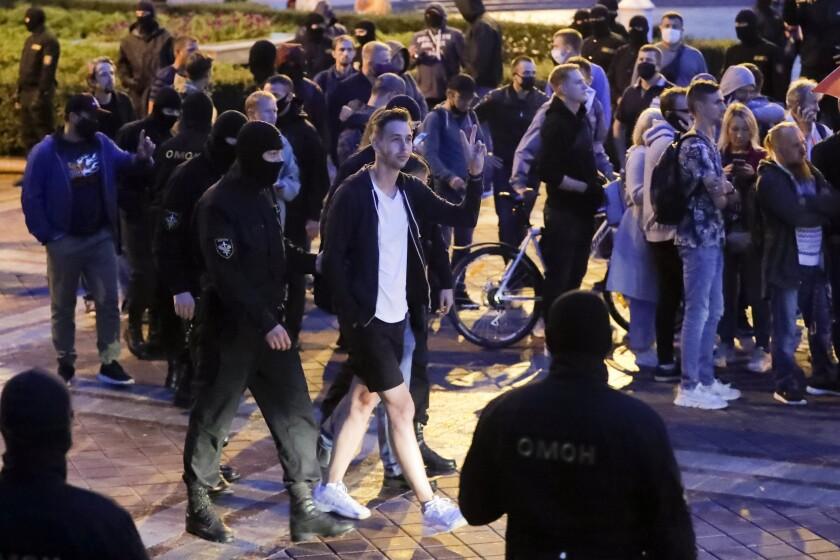Police detain a protester in Minsk.