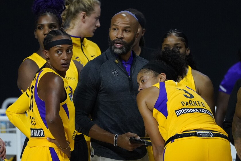 Sparks head coach Derek Fisher talks to guard Brittney Sykes and forward Candace Parker.