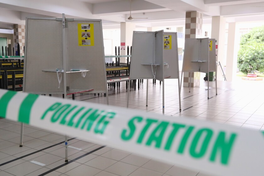 In this handout photo provided by the Ministry of Communications and Information, polling stations have been set up at Chung Cheng high school Thursday, July 9, 2020 in Singapore. Friday's general election in Singapore will be the first in Southeast Asia since the coronavirus pandemic began, with the health crisis and a grim economy expected to bolster Prime Minister Lee Hsien Loong's party and extend its unbroken rule. (Singapore Ministry of Communications and Information via AP)