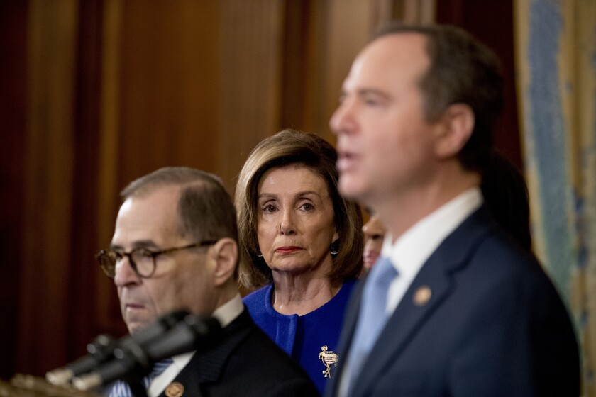 House Speaker Nancy Pelosi watches as Reps. Jerrold Nadler, left, and Adam B. Schiff speak at Tuesday's news conference announcing articles of impeachment against President Trump.