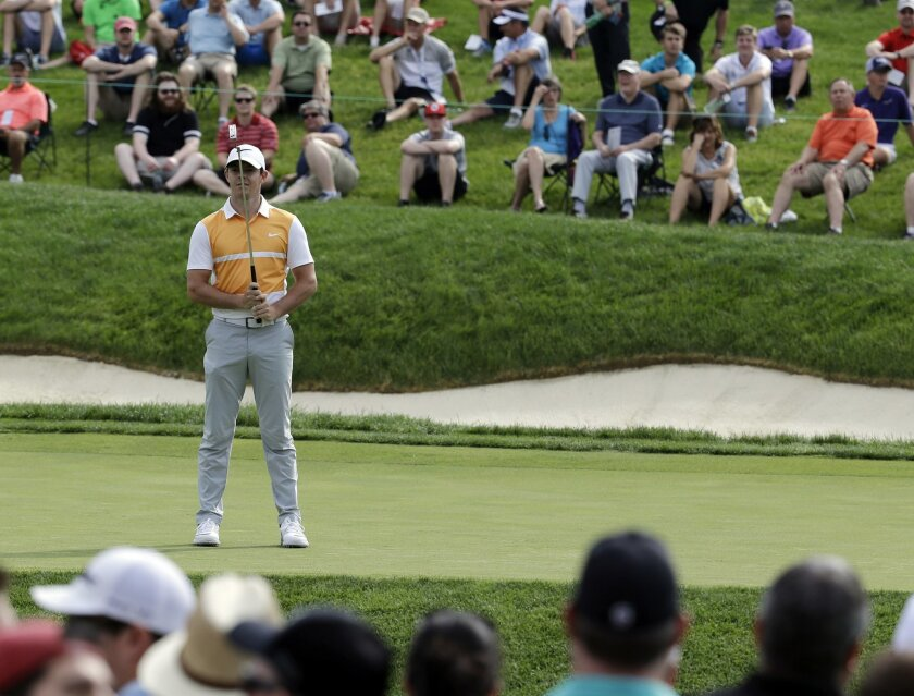 Rory McIlroy, of Northern Ireland, reacts after missing a putt on the 14th hole during the first round of the Memorial golf tournament, Thursday, June 2, 2016, in Dublin, Ohio. (AP Photo/Darron Cummings)