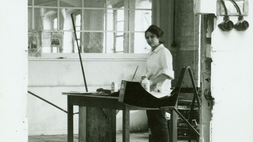 Eva Hesse in her studio at an old textile factory in Kettwig, Germany, in 1