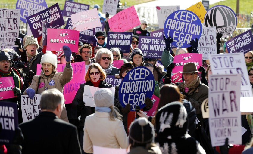 Abortion rights advocates rally in Richmond, Va., marking the 40th anniversary of the landmark Supreme Court ruling on abortion known as Roe vs. Wade.