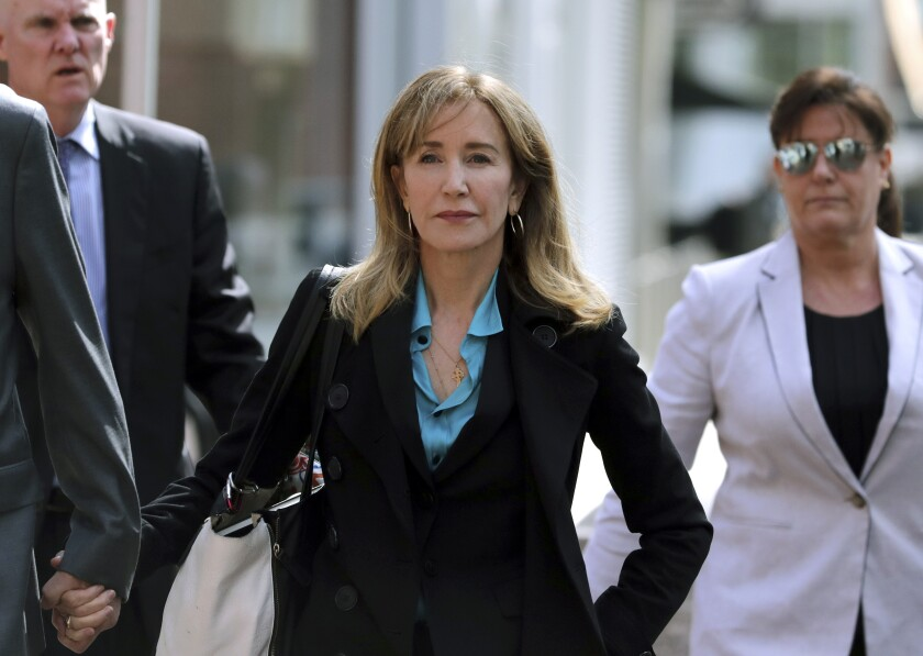 Actress Felicity Huffman arrives at federal court in Boston in April to face charges in a nationwide college admissions bribery scandal.