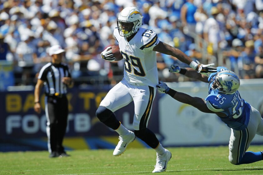 Chargers Ladarius Green makes a catch by Lions Stephen Tulloch.