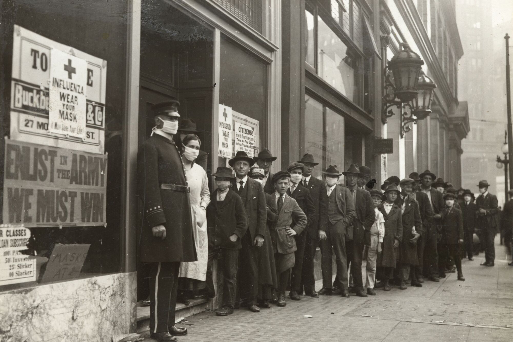 People wait in line to get flu masks on Montgomery Street in San Francisco in 1918.