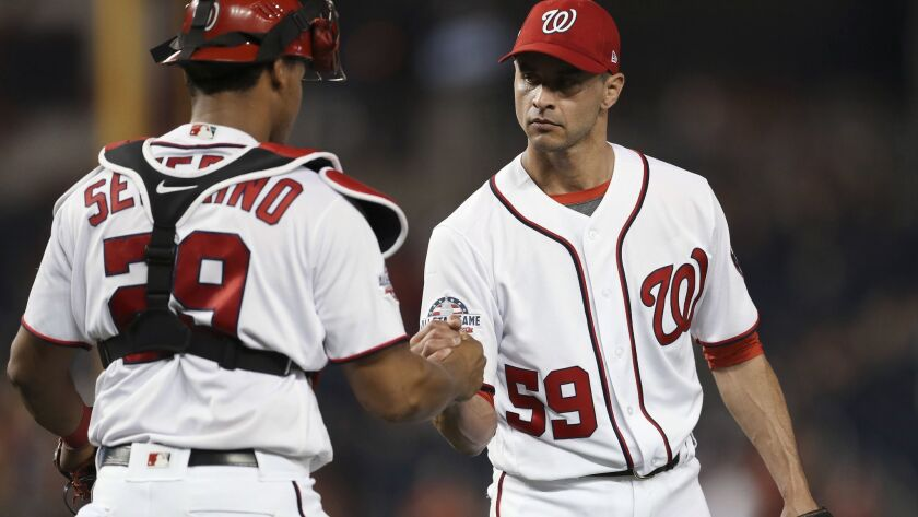 Washington Nationals relief pitcher Carlos Torres (59) and catcher Pedro Severino celebrate after the Nationals defeated the Pittsburgh Pirates 9-3 in a baseball game at Nationals Park, Wednesday, May 2, 2018, in Washington.