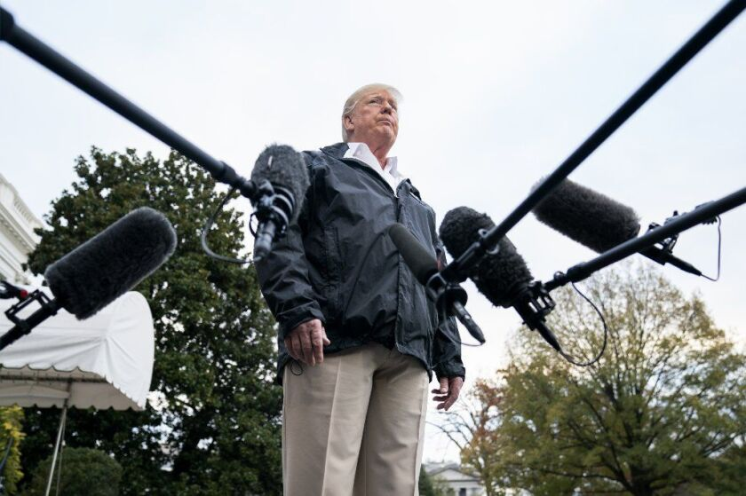 President Trump speaks to the media before departing the White House for California on Saturday. He was briefed on the CIA's report on the killing of Jamal Khashoggi.