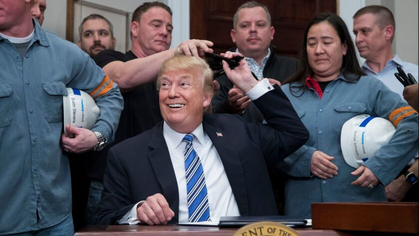 US President Donald J. Trump signs a presidential proclamation on tariffs, Washington, USA - 08 Mar 2018