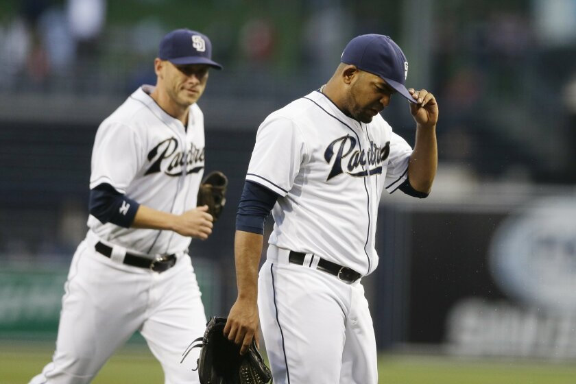 San Diego Padres starting pitcher Odrisamer Despaigne walks off the field ahead of shortstop Clint Barmes after giving up four runs during the first inning in a baseball game against the Washington Nationals on Friday, May 15, 2015, in San Diego. (AP Photo/Gregory Bull)