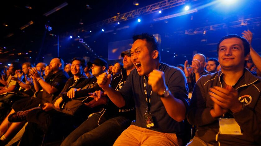 Fans go crazy after hearing new game announcements at Activision's annual BlizzCon fan convention at the Anaheim Convention Center. Activision is among companies that are boosting their parental leave benefits to attract workers.