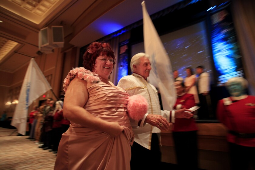 """Amy Campbell, 49, is escorted by her father Fred Campbell during Amy and Mark's wedding at the annual """"Star Trek"""" convention at the Rio hotel and casino in Las Vegas."""