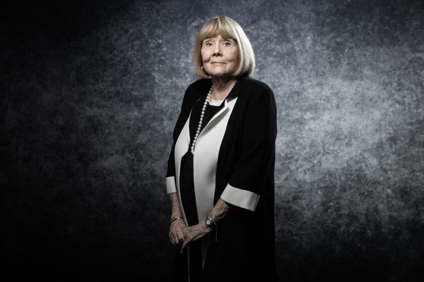 English actress Diana Rigg poses for a photo portrait at Cannes film festival in April 2019.