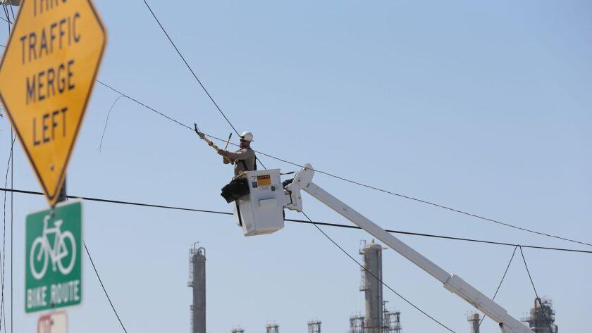 TORRANCE, CA, SUNDAY, SEPTEMBER 15, 2013 - Gary Hatfield of Southern California Edison, cuts a light