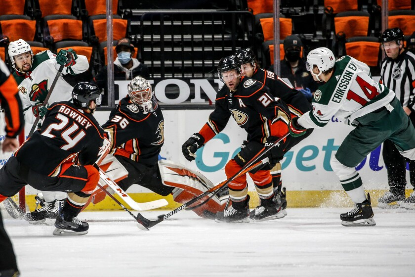The Wild's Joel Eriksson Ek (14) shoots as Ducks goalie John Gibson (36) defends during the second period Feb. 20, 2021.