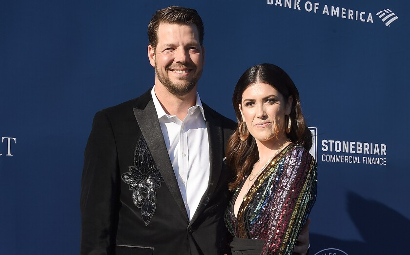 Rich Hill and his wife, Caitlin, arrive at an event at Dodger Stadium on June 12.