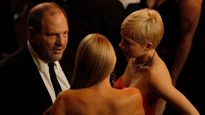 Harvey Weinstein and Michelle Williams at the 84th Annual Academy Awards show in Los Angeles on February 26, 2012.