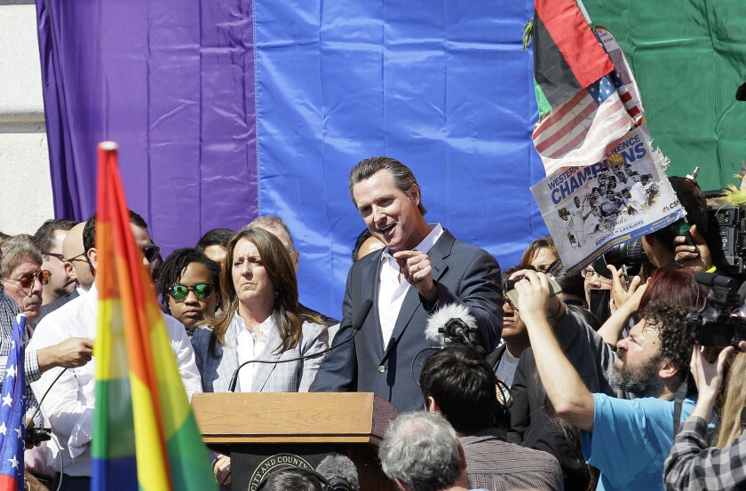 Lt. Gov. and former San Francisco Mayor Gavin Newsom speaks at a celebration outside City Hall on Friday after the Supreme Court approved gay marriage.