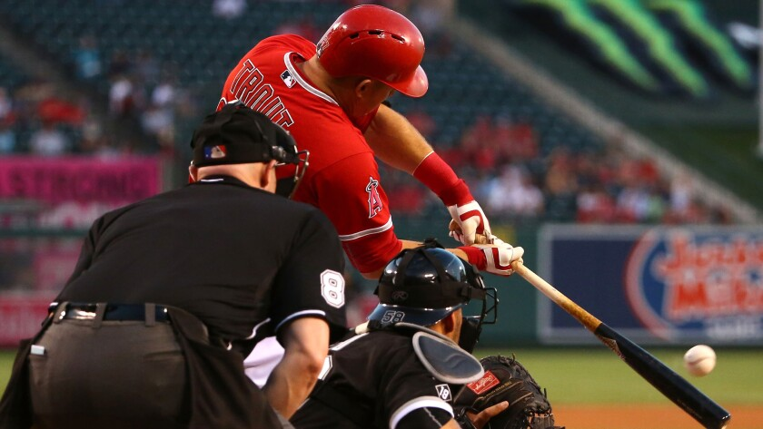 Angels center fielder Mike Trout connects for a run-scoring double against the White Sox in the first inning Thursday night in Anaheim.