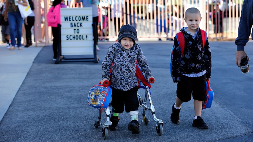 Lucian Olivera, left, and his brother Nikolas attend Peach Hill Academy Elementary School in Moorpark on the first day of school.